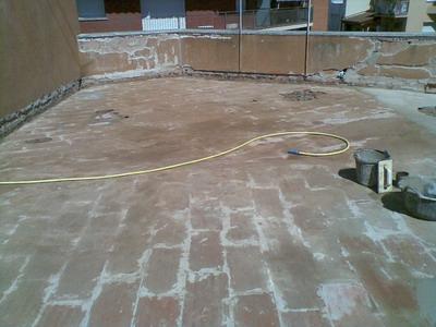 Extracción pavimento e impermeabilización antigua